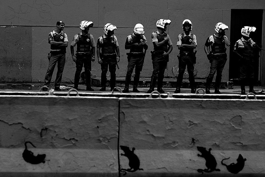 Police stands in front of a occupied building by the Movimento dos Sem Teto, Sao Paulo, Brazil, 2007.