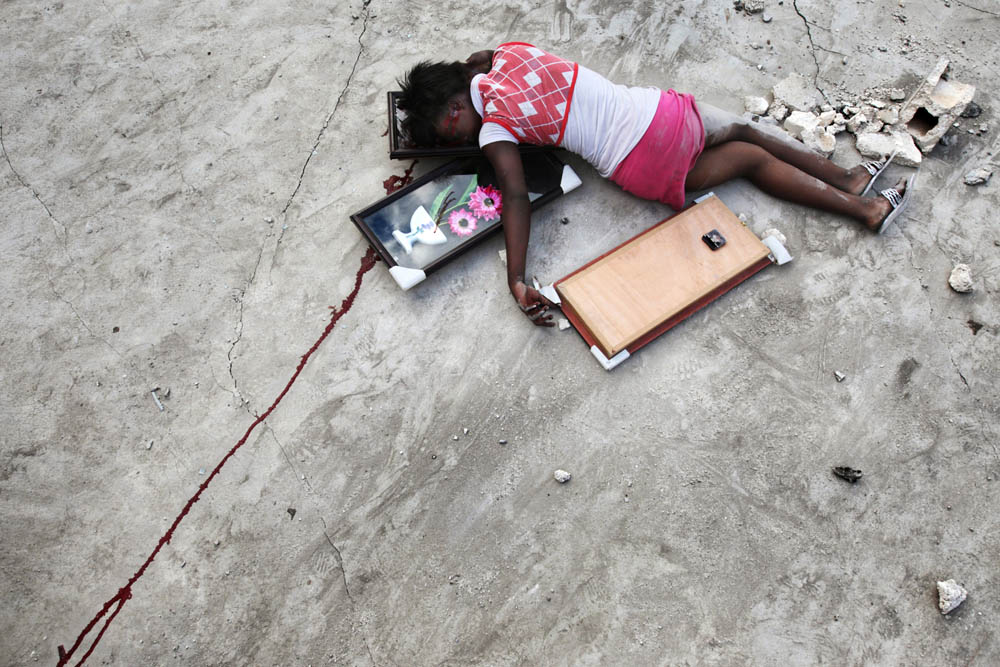 Fabienne Cherisma (15). She was shot by a policeman during the violent aftermath of the catastrophic earthquake that struck Haiti in 2010. Port-Au-Prince.