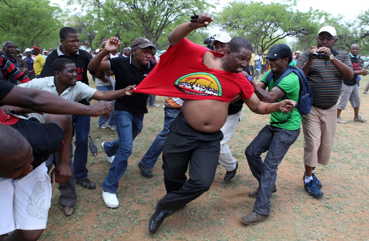 Union member Billy Zulu is beaten by striking Platinum workers in the unrest that followed the Marikana Massacre.