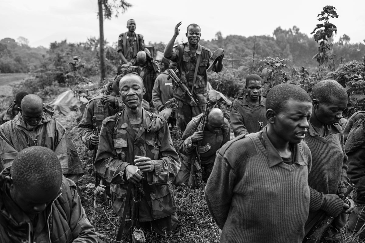September 01, 2013. Congolese army Chaplain Lieutenant-Colonel Aaron Kubuta (at rear) and his assistant Chaplains pray with Congolese soldiers near the frontline as FARDC continued to push M23 away from Goma.