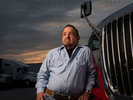 """Blake Alford,73, reminisces about his truck driving career at a truck stop south of Atlanta.  He worked as a long-distance truck driver for more than 30 years as Rebecca Alford before transitioning to his more authentic male gender at 56. """"I was just this lesbian trucker for years. I didn't transition until my mother passed. I didn't want her to be embarrassed that her daughter was really her son. But I think she would have liked me as Blake. I remember her telling me she just wanted to see me happy. And I'm finally happy in my own skin now. I'm at peace,"""" he said. Alford has since retired, but would get back behind the wheel """"in a heartbeat, if I had that opportunity,"""" he said."""