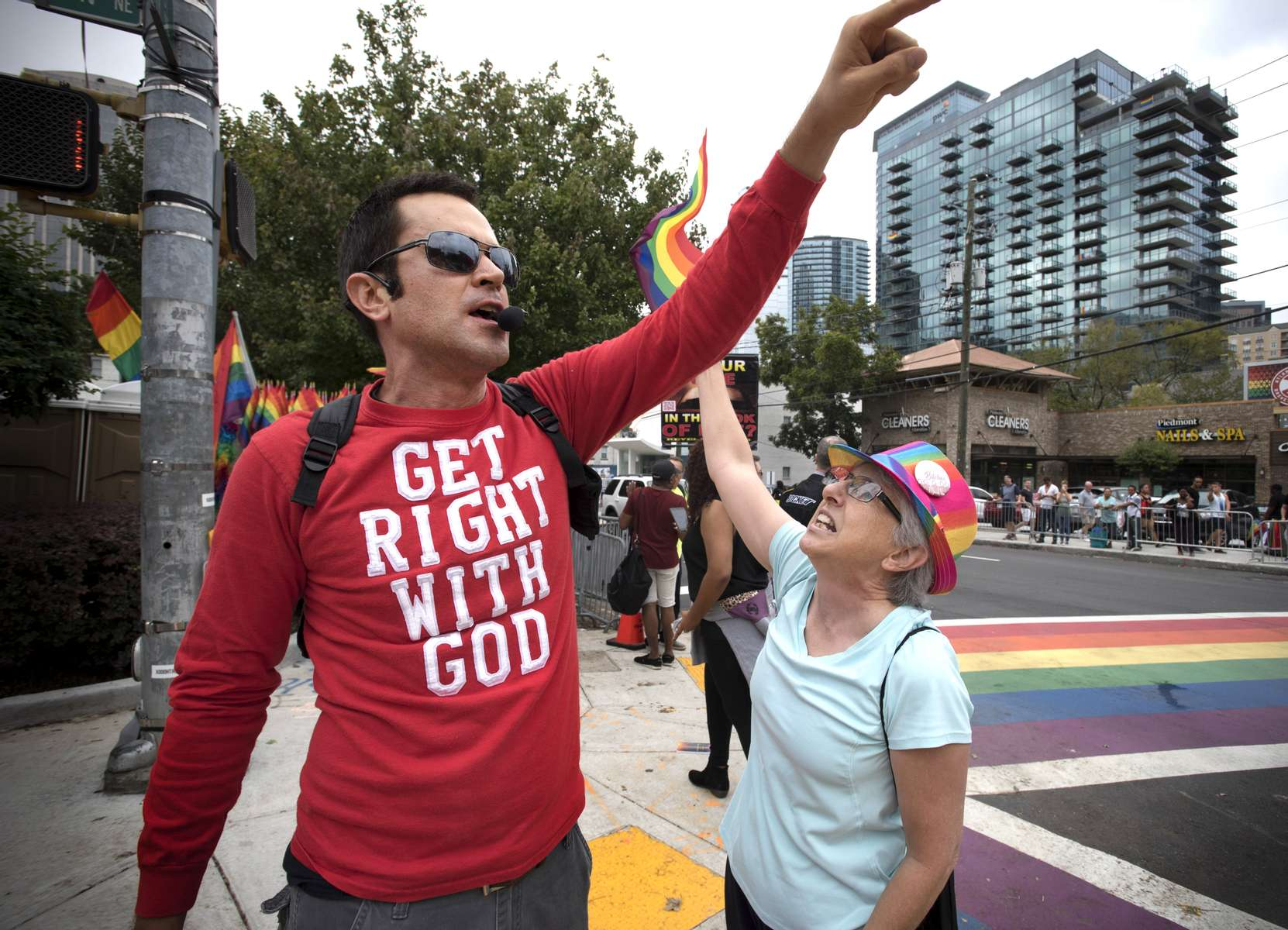 October 14, 2017 - Atanta, GA - A street evangelist preaches from street corner in center of Atlanta's midtown, 'ground zero' for the city's LGBTQ community. A senior citizen who is a strong gay and transgender rights advocate tried to initiate a conversation with the preacher but was unsuccessful. (Credit Image: © Robin Rayne/ZUMA Wire)