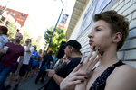 Mitch Le Luxe, a transgender teen, watches the crowd at  Gay Pride festival. He moved to Atlanta from rural Arkansas. In the midst of the conservative  and often bigoted South, Atlanta is considered an oasis of acceptance of the transgender community.