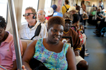 Decatur GA -- Lois Curtis rides MARTA rapid transit train with friends from Peer Center to book fair on the town square.