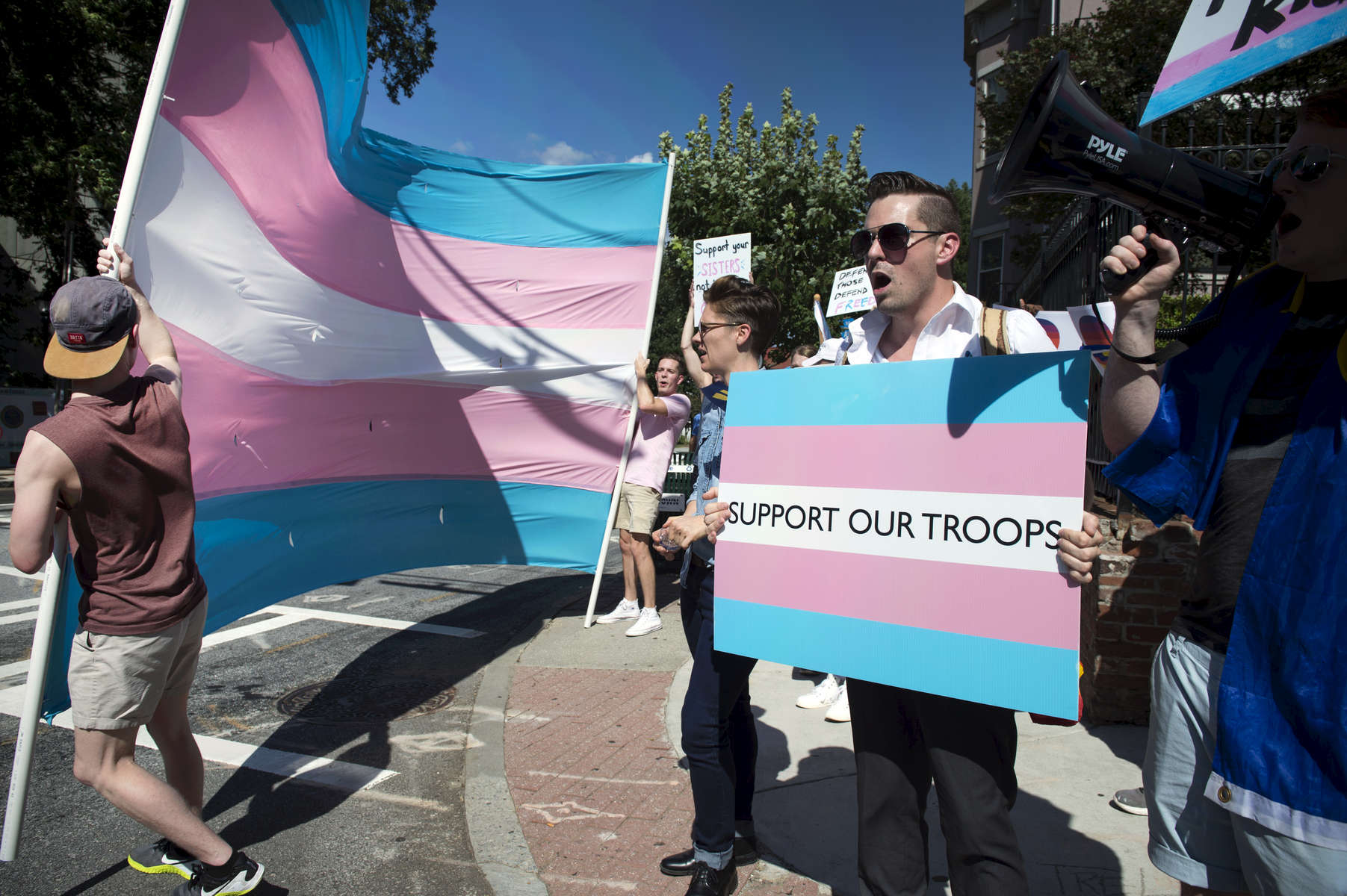 Transgender community, family and allies rally and march in Midtown Atlanta to protest President Trump's recent tweet about transgender individuals in the  military service.