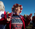 Hundreds  Republicans from Atlanta's northern suburbs gather outside a county office building for rally supporting candidates Kelly Loeffler and David Perdue, both seeking election in a Jan. 5 run-off vote. Pictured: Deloris Franklin, 75, from Woodstock, GA,  prays for a vote recount in Georgia