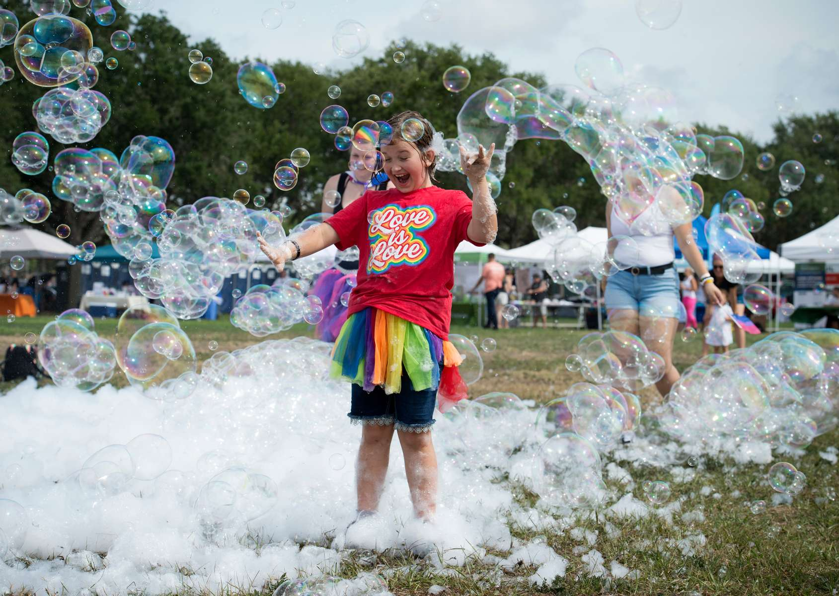 Shane Summers, a gender-fluid preteen, plays in a field of large bubbles at the city's OUT in the Park Gay Pride Festival on Tampa Bay.  Instead of hosting one of the  largest Gay Pride parades in the country, local organizers opted for a series of smaller events spread throughout June, considered Gay Pride Month.The scaled back celebrations were due to COVID-19 precautions, though few attending Saturday's waterfront OUT in the Park festival used masks.