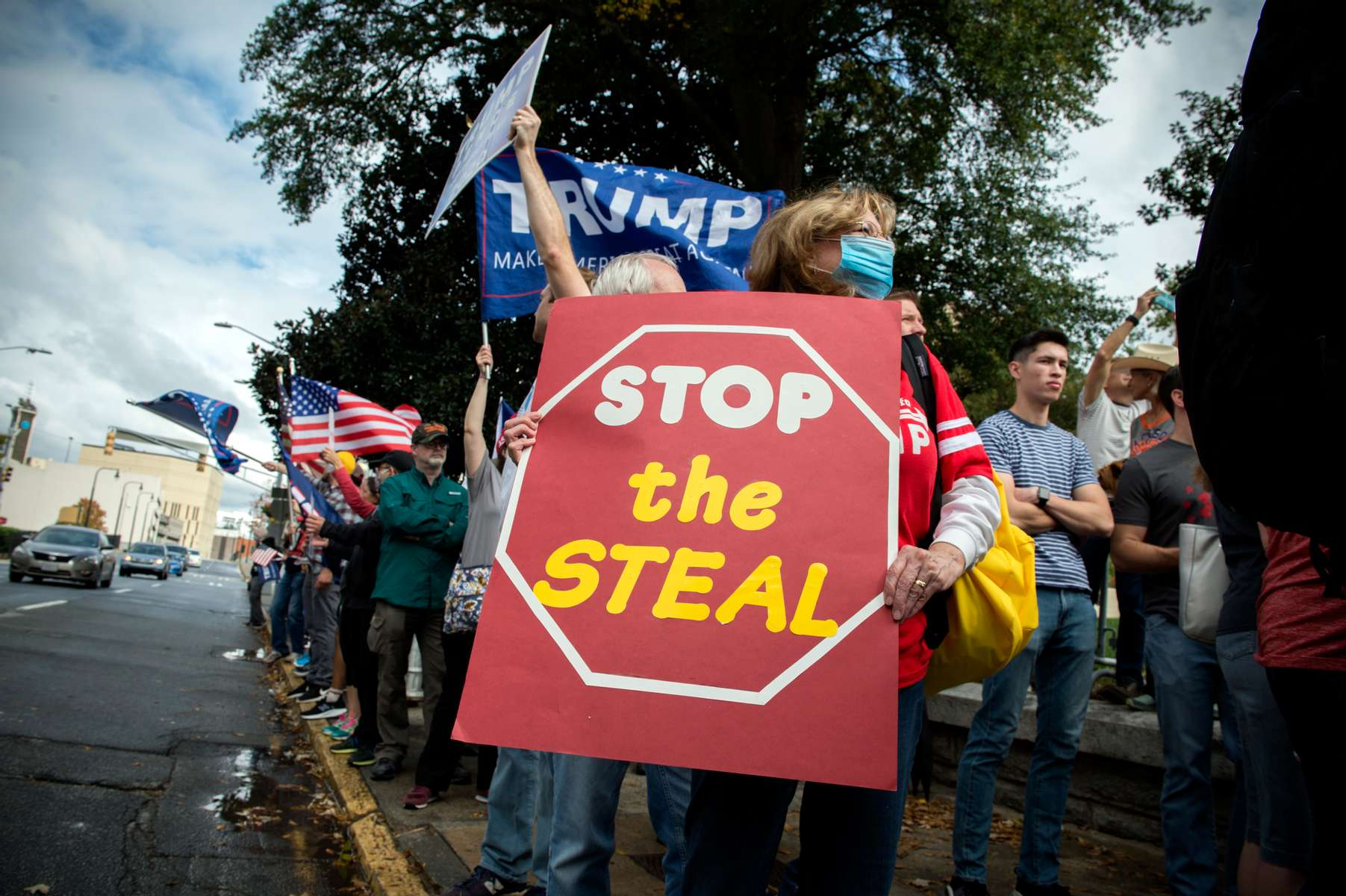 Republican Trump supporters protest what they claim are illegal mail-in votes in Georgia election at 'Stop the Steal' demonstration outside Georgia statehouse Saturday, at the same time hour former Vice President Joe Biden was declared  unofficial winner of 2020 presidential election.