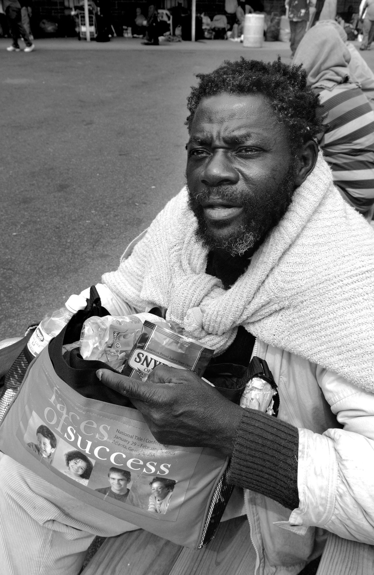 Homless, unemployed and with nowhere else to go, a man waits for the shelter to open for a Thanksgiving Day meal.
