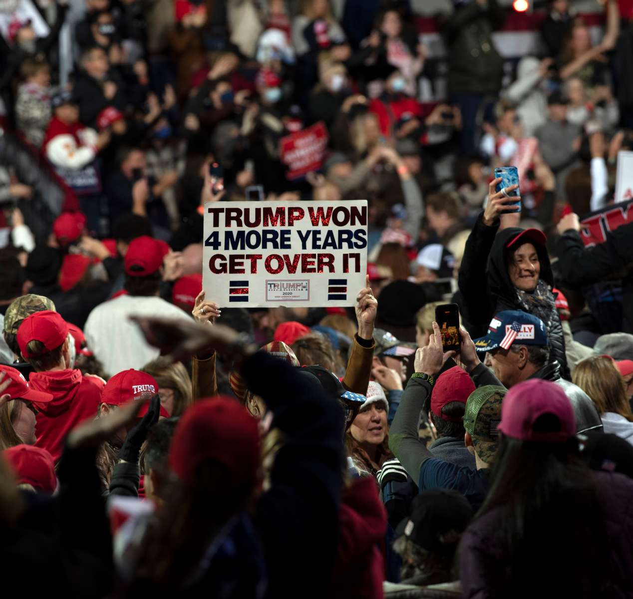 Thousands of Trump supporters converged on small town for Georgia Victory Rally to show support for President Donald Trump and two Republican incumbent U.S. senators Kelly Loeffler and David Perdue, who face democratic challengers in special run run-off election January 5, 2021. The election could decide control of the U.S. Senate.Pictured: Crowd erupts in cheers at end of rally, holding on to hope of a second term for President Trump despite election results
