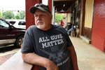 Bill Williams, 64, of Acworth, Ga, is a regular visitor and customer to Dent Myers' Civil War Surplus shop. Williams is a strong advocate for open carry firearms laws. He was on the watch for protesters who were expected later in the day.