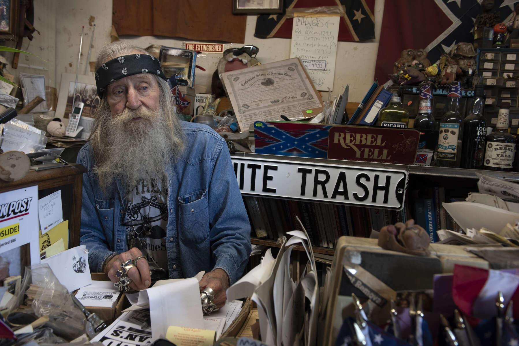 Dent Myers in his cluttered 'Wildman's 'Civil War Surplus shop.