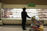 Empty shelves at a Publix Supermarket north of Atlanta, after a massive panic-buying crowd swarmed the store to stockpile groceries and bath tissue, fearing long weeks in self-imposed isolation because of the spreading coronavirus threat.Pictured: a local resident empty chicken and turkey, hoping to find one package left