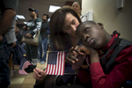 More than 140 immigrants recite  the Oath of Allegiance during ceremony at the federal Citizenship and Immigration Services office Wednesday as they become United States citizens.
