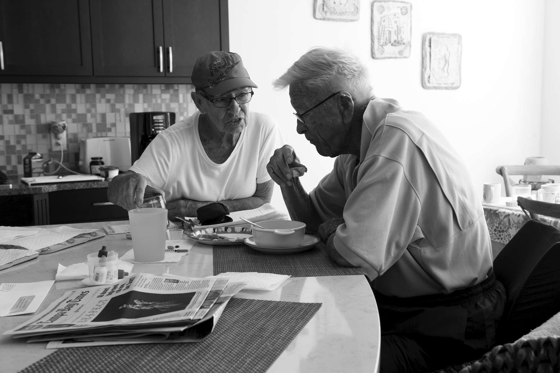 Virginia Minda reminds her husband Ki of the medications he forgot to take as he eats breakfast. Ki was a gregarious, extroverted and successful business executive for most of his life until vascular dementia affected his cognitive functioning and memory.