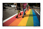 LGBT community celebrates Gay Pride in the city's midtown neighborhood, drawing thousands from across the South. Pictured: crosswalks at 10th and Piedmont Avenue are painted with Gay Pride colors for the weekend.