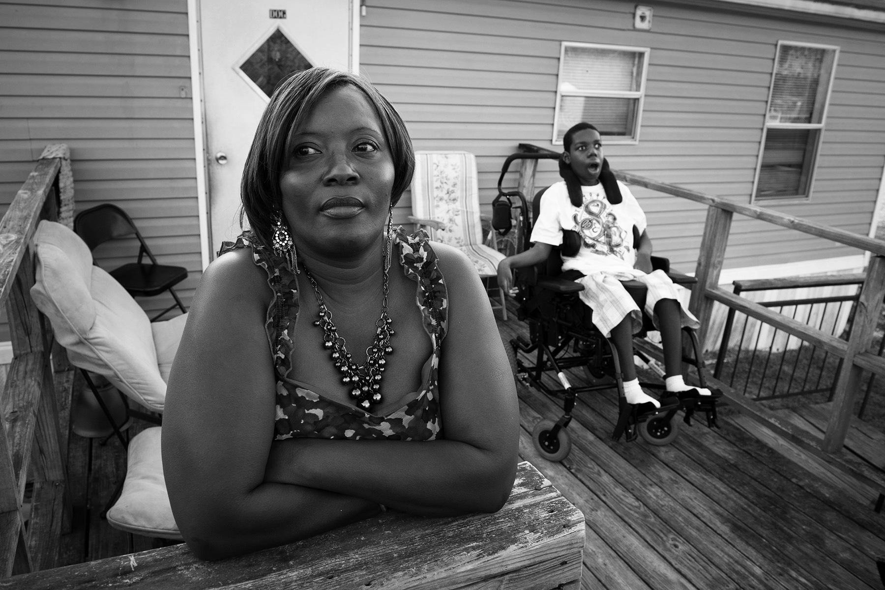 Essie Evans is a single mother in rural south Georgia with a profoundly disabled son Cornelius, now 16. Diagnosed with mitochondrial encephalomyopathy , he can't speak, walk, move or care for himself. She struggles to fore for him in her modest mobile home, yet steadfastly refuses to place him in a nursing home. {quote}He needs to be with  people who love him,{quote} he said.  {quote}He's in there, I know it,{quote} Essie says of her son.