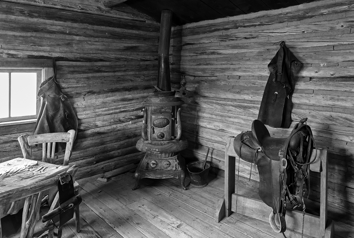Black and White Photograph of Genuine old log cabins and businesses from the Wild West Moved to The Museum and RestoredImage No: 17-017000-BW  Click HERE to Add to Cart