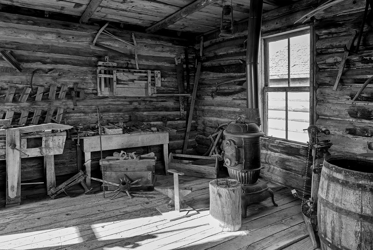 Black and White Photograph of Genuine old log cabins and businesses from the Wild West Moved to The Museum and RestoredImage No: 17-016899-BW  Click HERE to Add to Cart