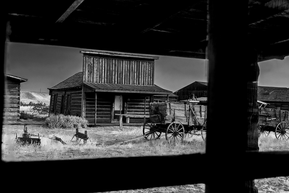 Black and White Photograph of Genuine old log cabins and businesses from the Wild West Moved to The Museum and RestoredImage No: 17-016975-BW  Click HERE to Add to Cart