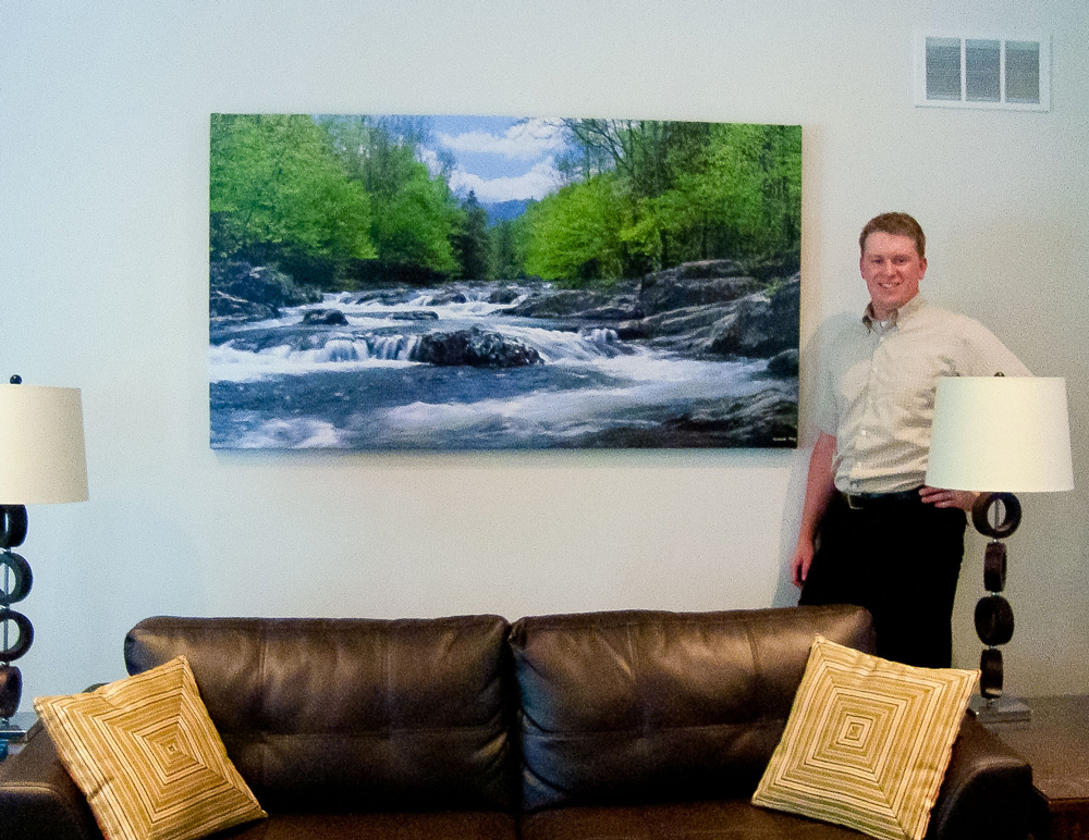 Scott next to his Canvas Gallery Wrap by Richard King which is 72 inches wide and 36 inches high.  The image is from the Great Smoky Mountains - Little Pigeon River