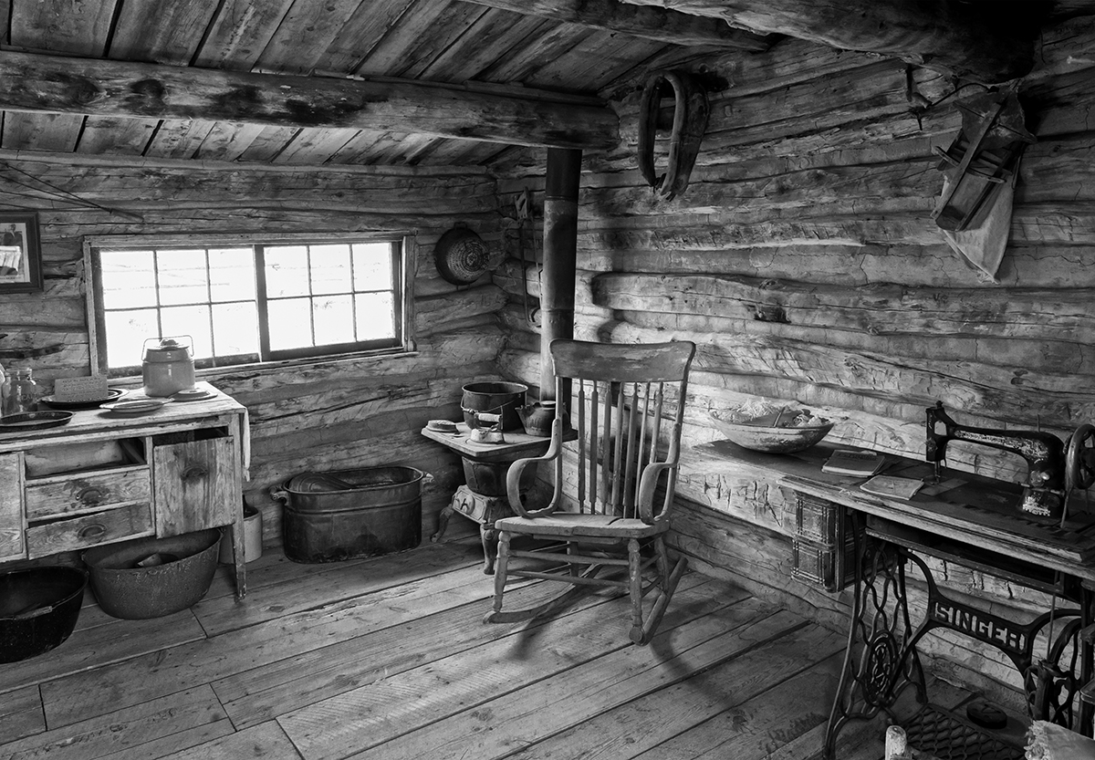 Black and White Photograph of Genuine old log cabins and businesses from the Wild West Moved to The Museum and RestoredImage No: 17-016914-BW  Click HERE to Add to Cart