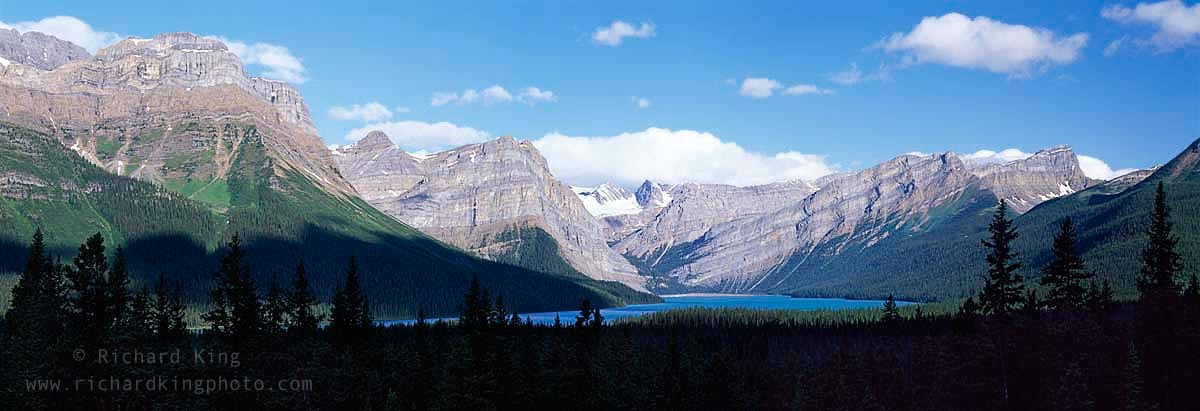 A panorama of Hector Lake nestled between the Crowfoot mountains and the Waputik Mountains,Icefields Parkway, Banff National Park, Alberta, Canada.Image No: 090394.0710  Click on link to add to cart  http://bit.ly/aTQaON