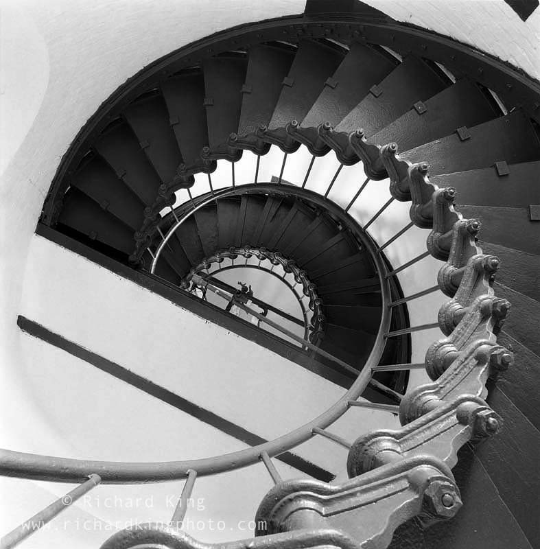 Looking up the spiral of thestairs inside the Hatteraslighthouse. With minimal lightgetting into the buildingthis was a 30 minuteexposure on black & white film.Image no: 050211.03Click on link to add to cart http://bit.ly/b7HEJS