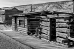 Black and White Photograph of Genuine old log cabins and businesses from the Wild West Moved to The Museum and RestoredImage No: 17-017048-BW  Click HERE to Add to Cart