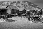 Black and White Photograph of Genuine old log cabins and businesses from the Wild West Moved to The Museum and RestoredImage No: 17-017119-BW  Click HERE to Add to Cart