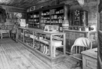 Black and White Photograph of Genuine old log cabins and businesses from the Wild West Moved to The Museum and RestoredImage No: 17-016952-BW  Click HERE to Add to Cart
