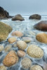 The giant pebbles (or are they called boulders) were getting nicely separated by the outgoing tide. I was inching my way towards the waters as they receded. With a 17 TSE lens tilted, I managed to shoot at a fairly wide aperture whilst extending my depth-of-field to the boulders in the background.