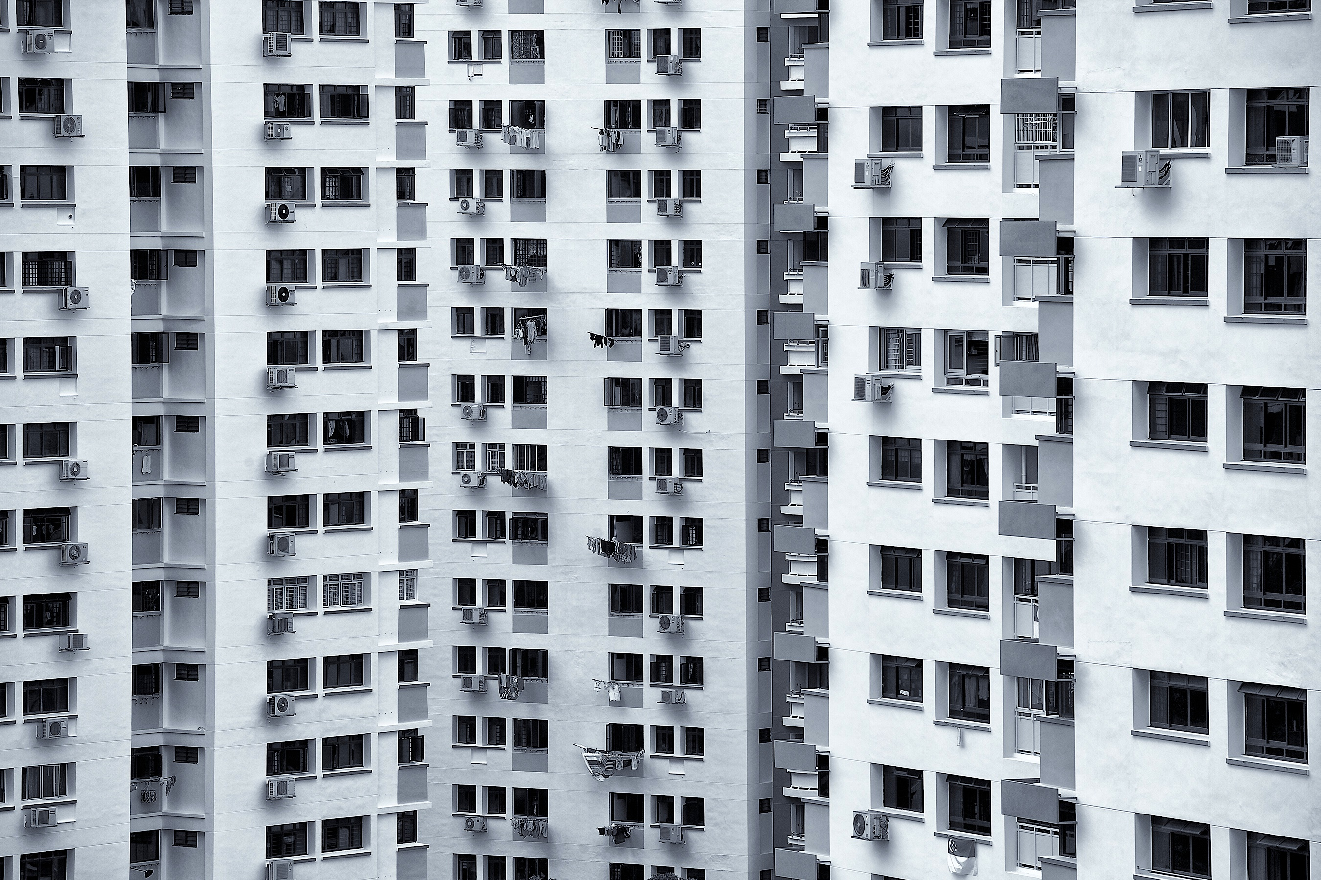 Part of the Patterned Heartlands Series. This image is taken as part of a Monochrome series showcasing Singapore's high-rise residential flats. Going towards an artistic vision, I factor in shapes and patterns when creating the shot. This is a compression of several blocks that are built almost right behind and beside each other. Also a series to show how fast our population is growing in this little red dot. Canon 5DMII, 70-300mm L IS, Post-processed with Silver Efex Pro.
