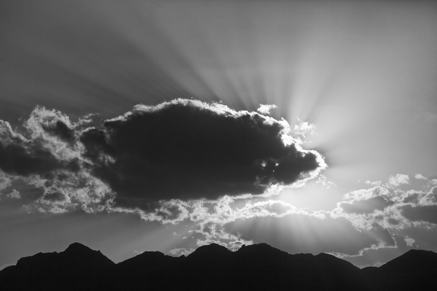 As I was processing this image, the shapes intrigued me more than when I was rushing to get the shot. The dark cloud and silhouetted hills stood out in good contrast against the setting sun. The coloured version seemed to rob that perception and thus the choice for a monochrome sunset.
