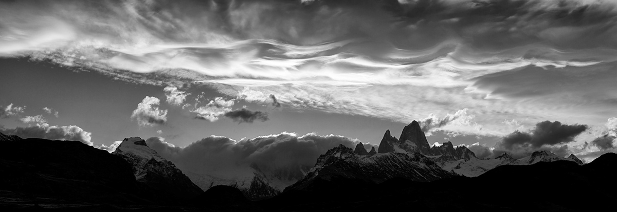 After bagging the previous image, I felt only a panorama could do justice to the long stretch of cloud formation above the mountain range.A stitch of close to 10 images was needed in this case.
