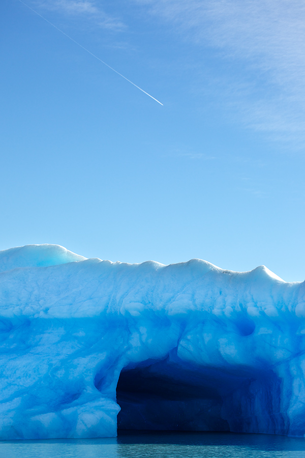 A contrail from a jet up above was just in line with a hole beneath Glacier Speggazzini.