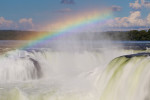A mistbow forms above the rushing waters of Devil's Throat. As the sun goes through its path in the sky, the mistbow appears in different positions throughout the falls.