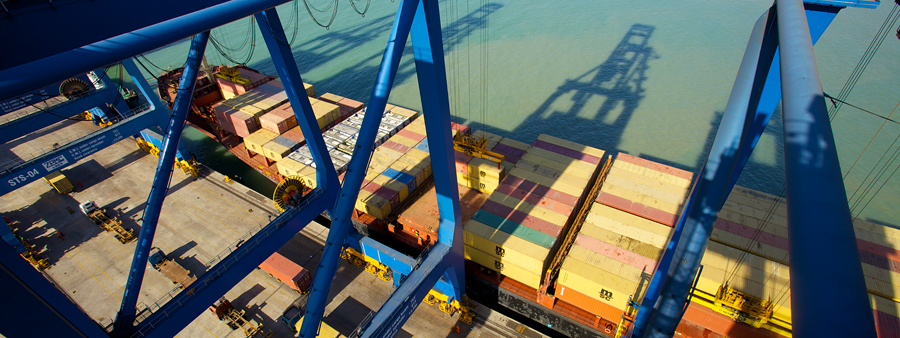 We were up there on the container cranes and 4 cameras had been set up for the timelapses. Lugging the fifth body and 2 lenses, I noticed the shadows of the cranes over the containers.