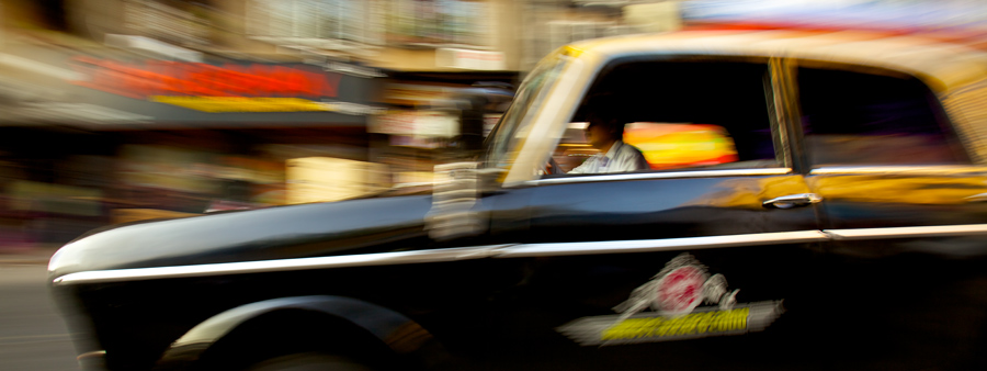 Ok, a confession here. The taxi was not really speeding, in fact it's almost impossible given the amount of traffic with ten times the number of pedestrians. Panning at a slow shutter speed gave the illusion of speed and a different feel to the photo.
