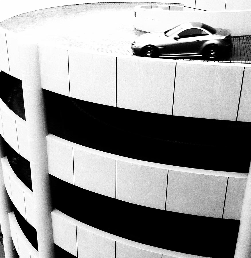 Photo for April 2011: SingaporeI was staring out the studio's window when I noticed the cars exiting the carpark. A couple of shots later, I was still unlucky in my timing and at long last, patience partnered luck and the last take got me this. A perfect silver-coloured car came by and I knew right away that the final image will make a great monochromatic image. The Edit function in Camera+ brought up the Ansel effect and a few seconds later, the image was saved and ready for viewing in the Camera Roll. Could I have done the same thing with Photoshop? Sure I could but that would require me to download the image, open up Photoshop, set the Curves and Channel Mixer and resave it and load it back into the iPhone.
