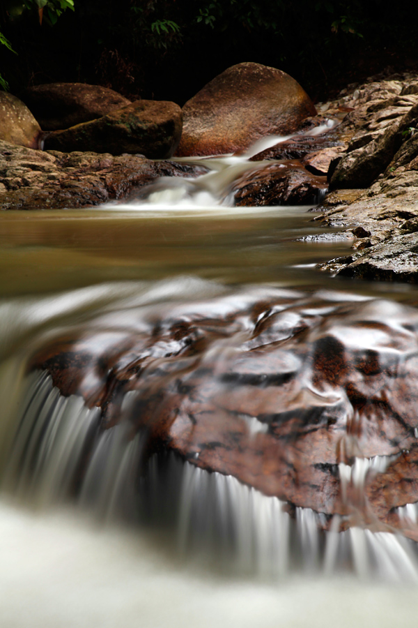 The rushing waters were {quote}calmed down{quote} by the use of slow shutter speeds. A fast shutter speed would have given an entirely different feel to the image.