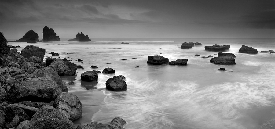 A somewhat tedious climb of both hard and softened rocks brought me to a aerial view of the boulders and waters. The light was however not ideal and that begged for a monochrome.