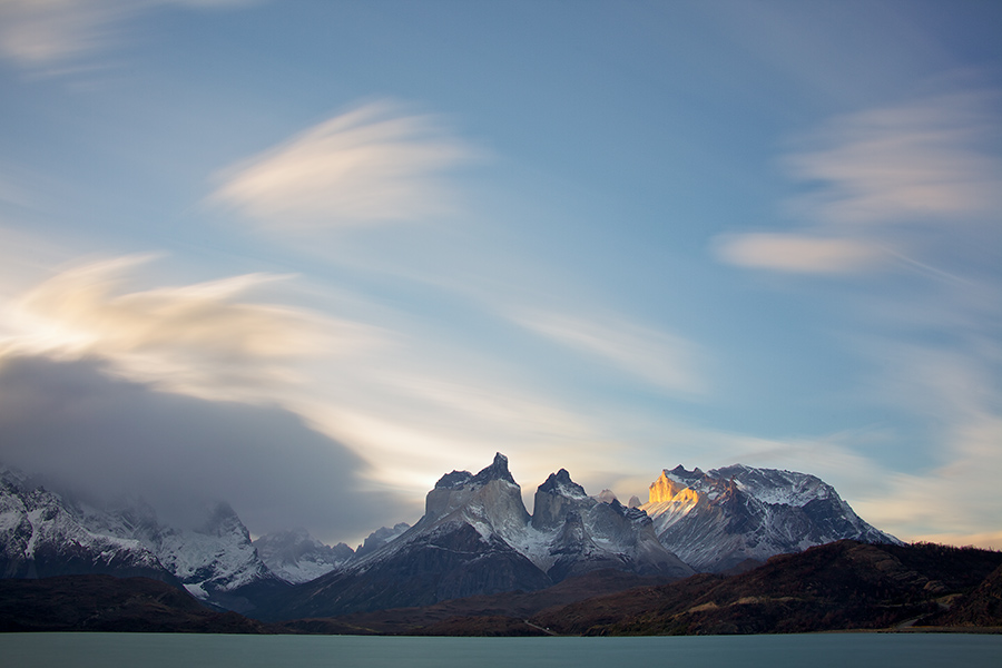 A long shutter speed provided some motion to the clouds as the sun lights up the Horns for the last time in 12 hours.