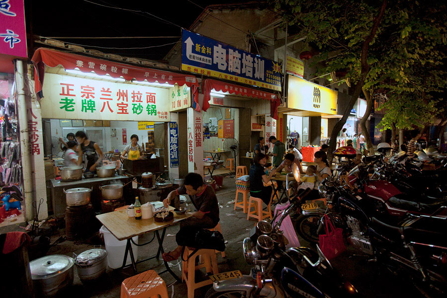 The rows and rows of shops, from eateries to shops selling electronics to clothing had motorbikes cramped in front of them. Night markets can be great for some photography but having some watching your back and bag is always a comfort.
