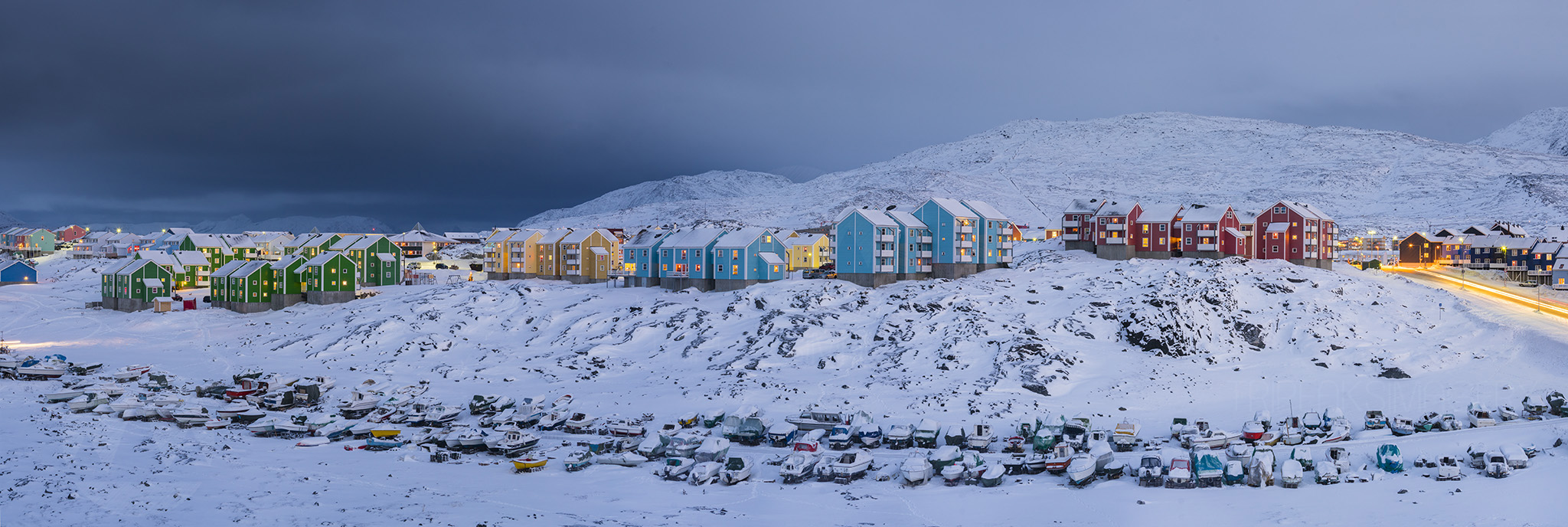 Winter Town, GreenlandNuuk, capital of Greenland shocked us with bitter cold and only a few depressing hours of sunlight everyday. It was by chance that we had this image as randomly walking around in deep snow coupled with a small dose of curiosity brought us into a housing estate. At the rear of it all laid this scene ahead. A multi-image pano with our new system, the Sony A7Rii, it proved a handful for our travel laptop of choice, an 11 inch MacBook Air to process the files. Sony A7Rii, Canon 70-300 IS L with Kipon adaptor. Processed in Lightroom CC.