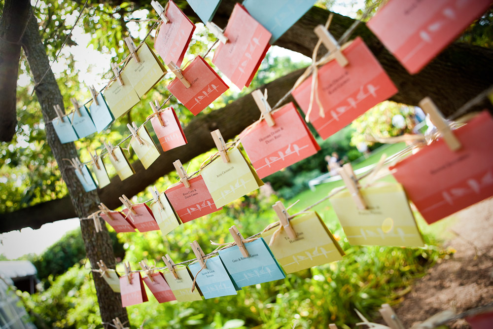 Wedding guests' place cards were strung between trees at an outdoor wedding near Stillwater, Minnesota.
