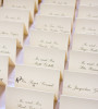 Oops! The bride pencilled in a name she omitted on a guest's place card.