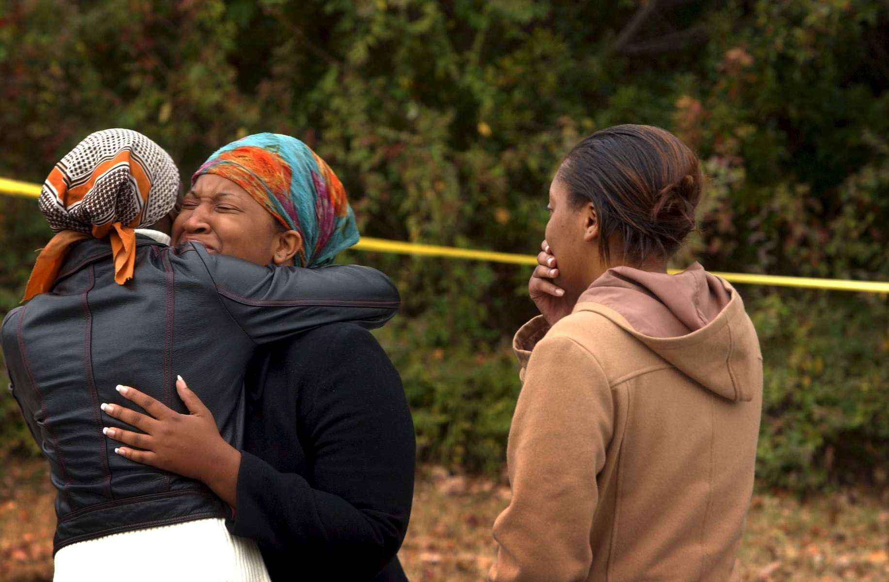 MURDERS2.NE.112005.SAS --  Friends of one of the shooting victims react as they arrive Sunday morning at 2222 Alpine Road in Durham where four men were shot to death and two others were injured Saturday night in what police are calling a home invasion. STAFF/SHER STONEMAN