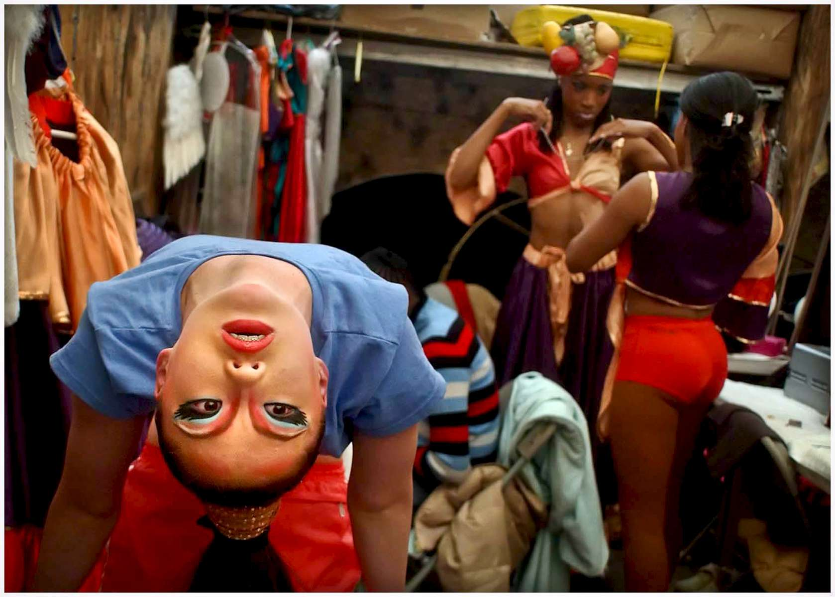 CIRCUS2.NE.042303.SAS -- Contortionist Ganbaatar Buyankhishig (CQ), left, warms up in the women\'s dressing room before performing Wednesday morning in the UniverSoul Circus in downtown Raleigh. The circus also features clowns, a low wire act, an aeriel act, magic, acrobats and more.The one-ring circus is celebrating its tenth anniversary season. STAFF/SHER STONEMAN