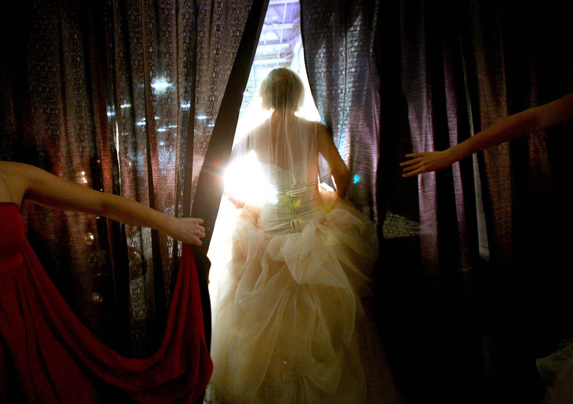 A bridal model makes a grand entrance during a wedding gown show in Milwaukee.